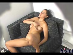 Kinky babe masturbates on a sofa