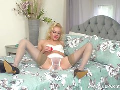 Racy blonde April Paisley strips off retro white lingerie fingers herself in sheer nylons heels