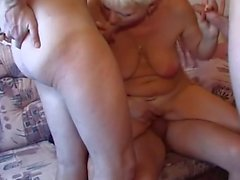 Busty Blonde Shorthair-MILF in Groupsex with some young Guys