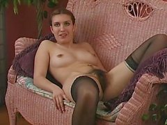 Hairy girl toying in black stocking