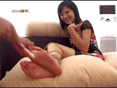 Chinese girl's bound feet tickled