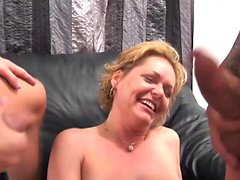 Mature blonde gets two hard shafts