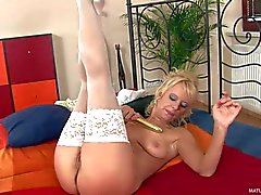 Blond mom Marylin in white stockings takes dildo