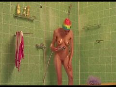 Hot woman make shower naked in rubber swimcap