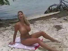 Blonde Amber Lynn is on the beach and on her knees getting fucked