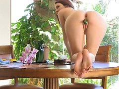 Brunette babe stuffs some cucumbers in her shaved pussy