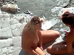 Voyeur on public beach.Sexual games