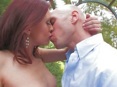 Redhead Karlie Montana gives suck job in the garden