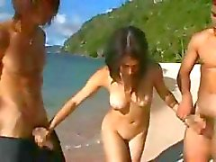 Oriental slut Maria Ozawa sucks cock and gets hammered in a threesome on the beach
