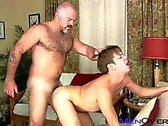 A hairy masculine daddy fucks a young college boy