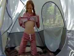 Hot ginger girl masturbates in a tent