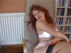 Stockinged British redhead shows what she likes most in masturbation