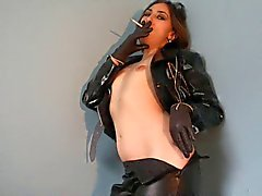 Smoking Brunette in Leather