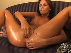 Oiled pussy fisting on sofa