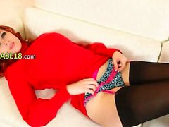 Redhead in nylons pose in red shoes