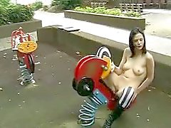 Goth girl naked on playground toys