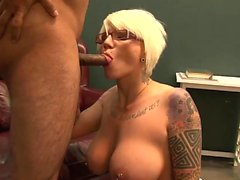 Babe with glasses sucks a pecker