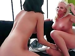 Old blonde and pretty brunette making love