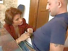 Busty mature fucked hard by the workman.
