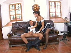 Sexy brunette maid fucks her bos on the sofa