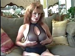 50's MILF Shows Off Her Body In Black Lingerie