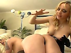 Blonde lesbians spank each other