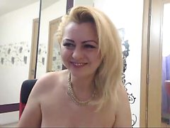 Busty mature blonde sits back and masturbates for her webca