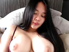 Cute Asian girl fingering on her webcam