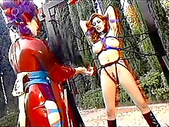 Lesbian bondage and whipping outdoors