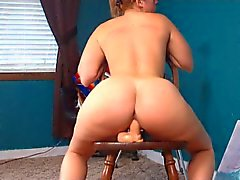 Pawg plays with her wet pussy and rides toy on chair