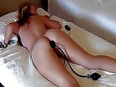 Girlfriend with a toy in her butt sucking my cock