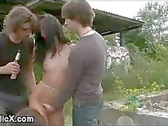 Brunette bdsm suspended and stripped outdoor