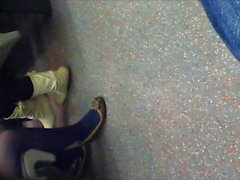 Blue pantyhose and flats on train