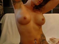 Inked step mom using lotion and playing