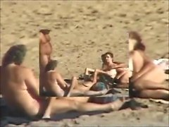 Groupsex at beach by voyeur
